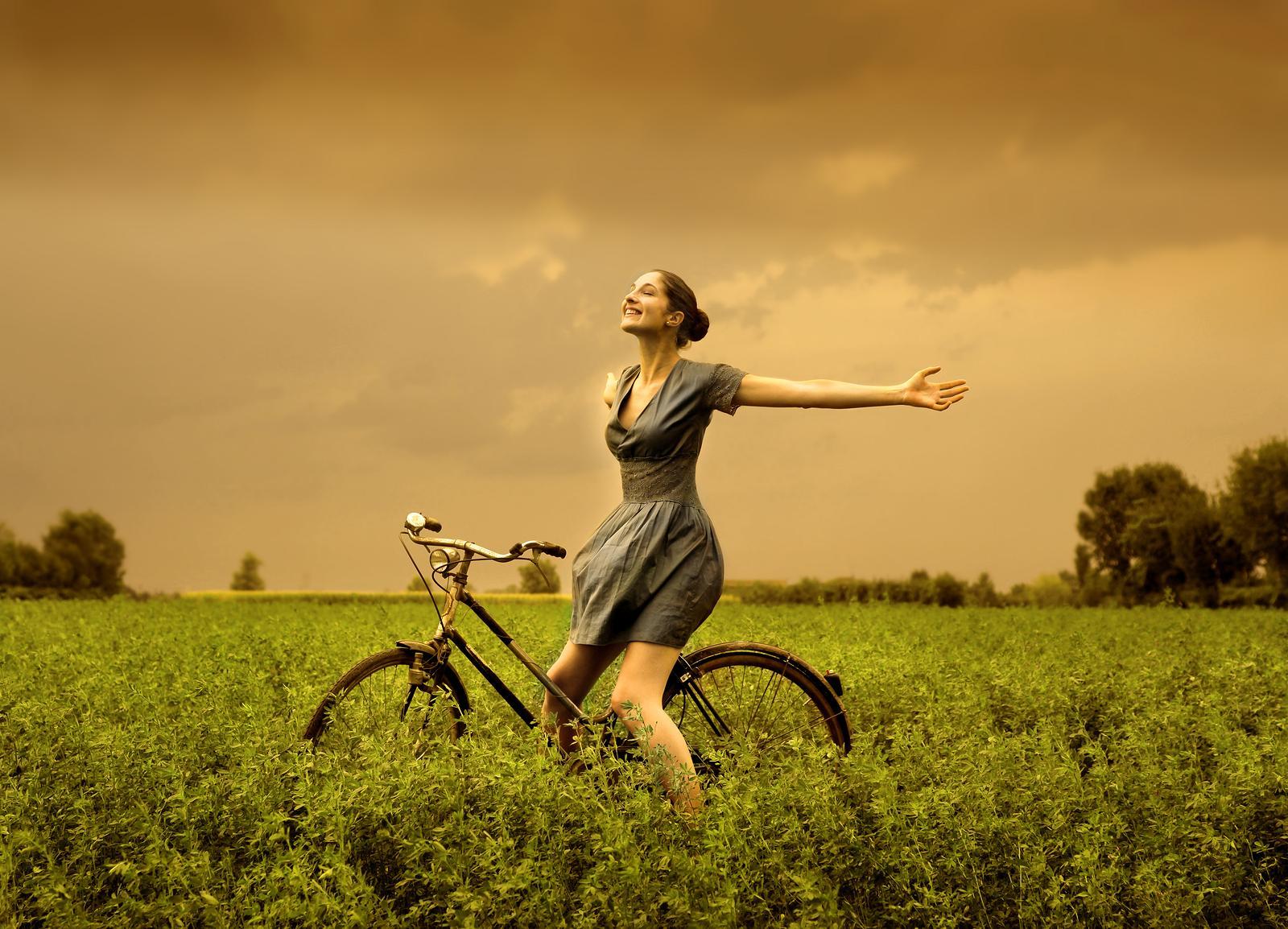 happy woman on bike